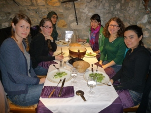 Nafisa (left at the back) enjoying a dinner with international students