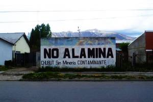 One of many examples of anti-mine graffiti, threatening the whole infrastructure of the area.
