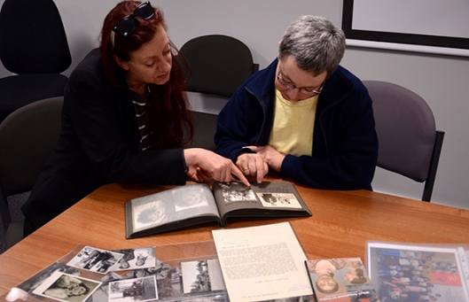 Jana Müller and Professor Eve Rosenhaft examine part of the collection of photographs of German Romani