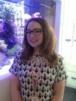 Lauren Bower at Bloomberg's London headquarters, in front of one of their tropical-fish tanks