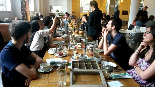 Léa Meignien and friends enjoying a traditional afternoon tea in Liverpool